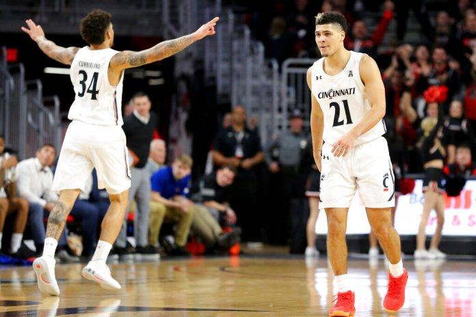 Cincinnati guards Jaevin Cumberland (21) and Jarron Cumberland (34) react after a 3-pointer against Tulsa during the second half of an NCAA college basketball game Wednesday, in Cincinnati.  Photo courtesy of Kareem Elagazzar/The Cincinnati Enquirer via AP