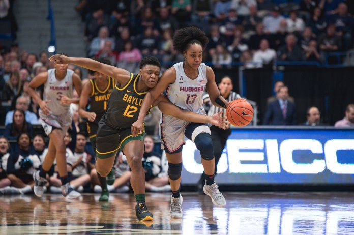 UConn's 74-58 loss to Baylor in early January. UConn women's basketball's Christyn Williams dribbles past Baylor's Moon Ursin.  Photo courtesy of Charlotte Lao, Photo Editor/The Daily Campus