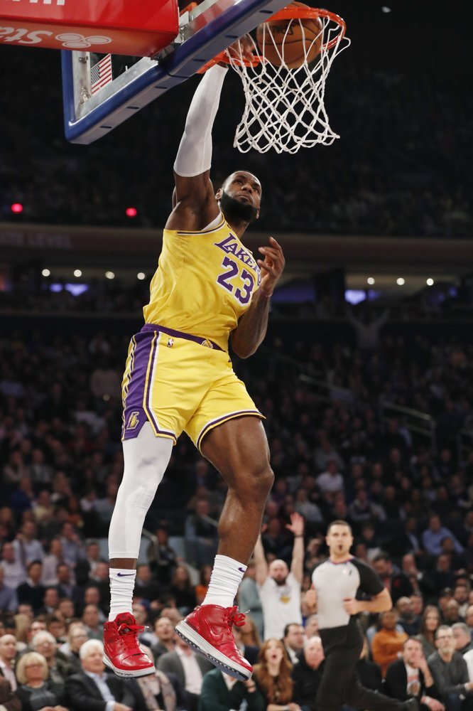 Los Angeles Lakers forward LeBron James dunks with no one around defending him during the first half of an NBA basketball game against the New York Knicks in New York, Wednesday. James is highly likely to earn his 16th All-Star selection.  Photo courtesy of Kathy Willens/AP Photo