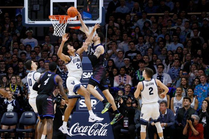DePaul's Jaylen Butz, right, cannot get a dunk past Villanova's Jeremiah Robinson-Earl during the second half of an NCAA college basketball game, Tuesday, Jan. 14, 2020, in Villanova, Pa. Villanova won 79-75 in overtime. (AP Photo/Matt Slocum)
