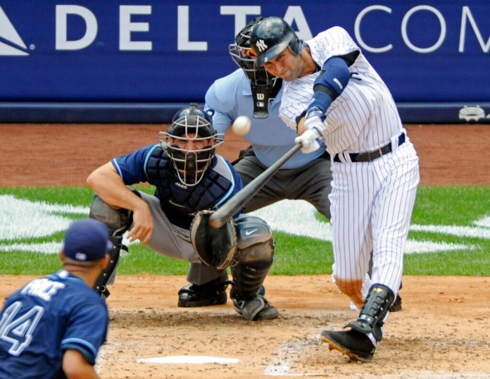 In this July 9, 2011, file photo, New York Yankees' Derek Jeter hits a home run for his 3,000th career hit during the third inning of a baseball game against the Tampa Bay Rays at Yankee Stadium in New York.  Photo by Bill Kostroun/AP