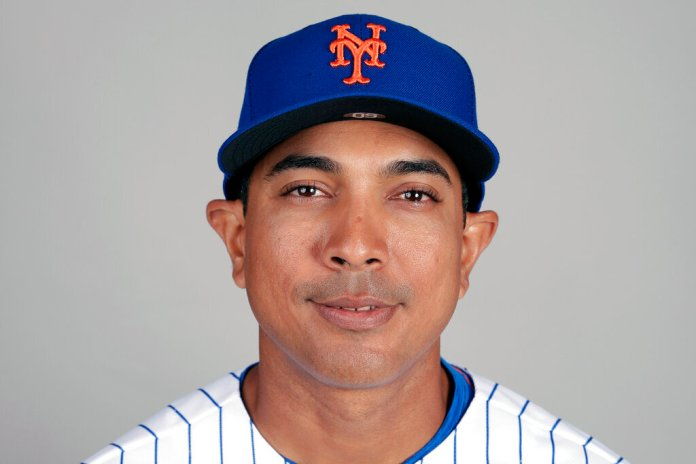 This is a 2019 photo showing Luis Rojas of the New York Mets baseball team. The New York Mets are finalizing a multiyear agreement with quality control coach Luis Rojas to make him the team's new manager, general manager Brodie Van Wagenen said Wednesday, Jan. 22, 2020.   Photo by John Raoux/AP