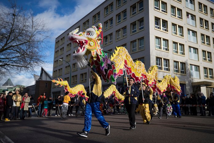 Dancers perform a dragon dance during the Chinese New Year Parade, in Vancouver, on Sunday January 26, 2020. (Darryl Dyck/The Canadian Press via AP)