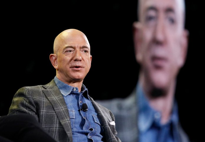 In this June 6, 2019, file photo Amazon CEO Jeff Bezos speaks at the the Amazon re:MARS convention in Las Vegas. Jeff Bezos is the Billionaire behind Amazon. (AP Photo/John Locher, File)