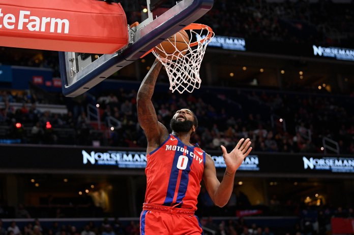 Detroit Pistons center Andre Drummond (0) dunks during the first half of an NBA basketball game against the Washington Wizards, Monday, Jan. 20, 2020, in Washington. (AP Photo/Nick Wass)