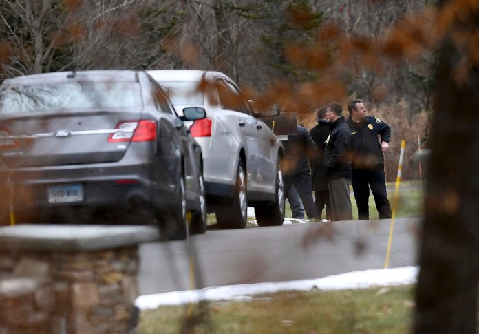 Police gather outside the driveway of Fotis Dulos, Tuesday, Jan. 28, 2020, in Farmington, Conn. A dispatcher from the Farmington police said officers had responded to Dulos' home and he was later transported to the hospital (AP Photo/Jessica Hill)