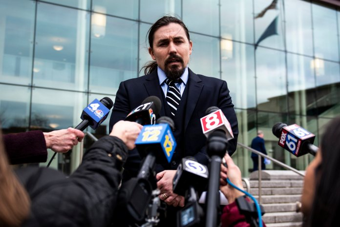 Kevin Smith, an attorney for Fotis Dulos, who is accused of murdering his estranged wife, Jennifer Dulos, talks to media outside of the Stamford Superior Courthouse, Tuesday, Jan. 28, 2020 in Stamford, Conn. A dispatcher from the Farmington police said officers had responded to Fotis Dulos' home and he was later transported to the hospital. (Kassi Jackson/Hartford Courant via AP)