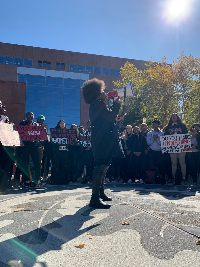 This morning at 12pm, UConn Students representing the Black Students Association (BSA), the NAACP of UConn, and other student organizations representing Black students took to the center of campus and marched for their voices to be heard in lieu of recent events of racism.   Photo by Eric Wang/The Daily Campus