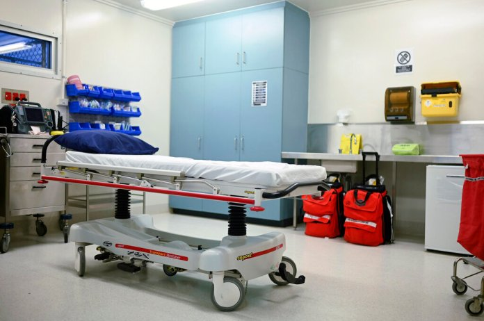 In this March 6, 2019, photo, a bed and equipment are set up in the medical facility of the North West Point Detention Centre on Christmas Island. Australia's government on Thursday, Jan. 30, 2020, defended its plan to send citizens evacuated from the epicenter of China's novel coronavirus emergency to the remote island used to banish asylum seekers and convicted criminals, despite warnings that that some Australians would prefer to stay in China.   Photo by Lukas Coch/AAP Image via AP