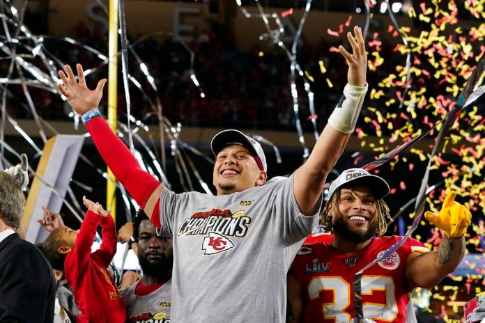 Kansas City Chiefs quarterback Patrick Mahomes and Tyrann Mathieu celebrate their Super Bowl victory on stage following the win Sunday in Miami.  Photo courtesy of Brynn Anderson/AP Photo