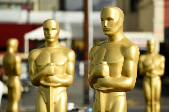 Oscar statues stand off of Hollywood Boulevard in preparation for Sunday's 92nd Academy Awards at the Dolby Theatre, Wednesday, Feb. 5, 2020, in Los Angeles. (AP Photo/Chris Pizzello)