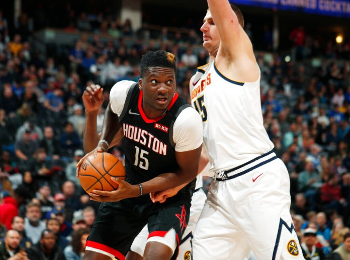 Houston Rockets center Clint Capela, left, drives to the rim as Denver Nuggets center Nikola Jokic defends in the first half of an NBA basketball game last Sunday in Denver. Capela was sent to the Atlanta Hawks in a four-team trade Wednesday night.  Photo courtesy of David Zalubowski/AP Photo