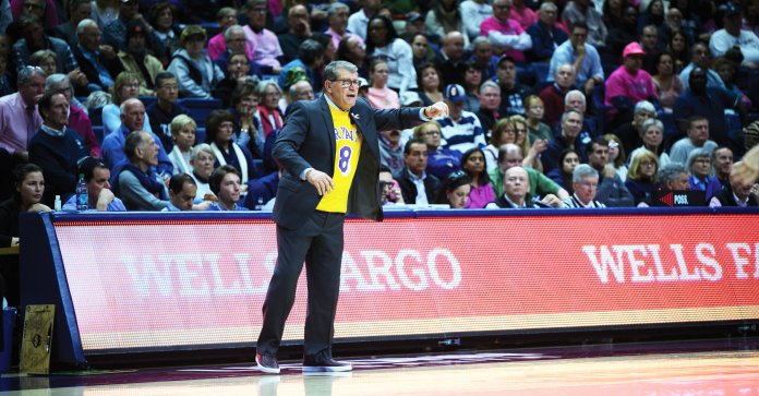 UConn women's basketball head coach Geno Auriemma sports a Kobe Bryant jersey during UConn's 18-point loss to Oregon Monday.  Photo by Charlotte Lao/The Daily Campus