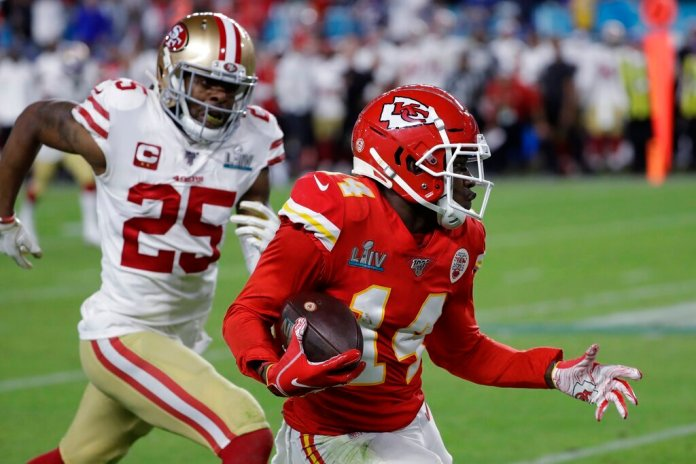 Kansas City Chiefs' Sammy Watkins (14) runs in front of San Francisco 49ers' Richard Sherman (25) during the second half of the NFL Super Bowl 54 football game Sunday, Feb. 2, 2020, in Miami Gardens, Fla.   Photo by Seth Wenig/AP