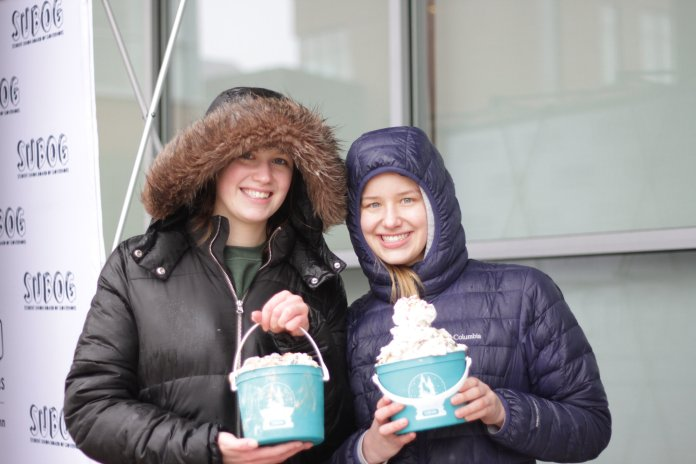 Students gathered on the Student Union Terrace to participate in the annual One Ton Sunday hosted by SUBOG. For only a dollar students filled an entire bucket with ice cream and toppings.   Photo by Sofia Langou/The Daily Campus