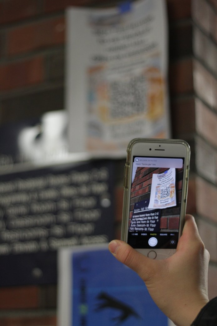 Residents of Buckley and Shippee advocate for Buckley dining hall to be open on the weekends. By scanning the posters UConn students can sign a petition to reopen the dining hall on the weekends.  Photo by Matthew Pickett/The Daily Campus