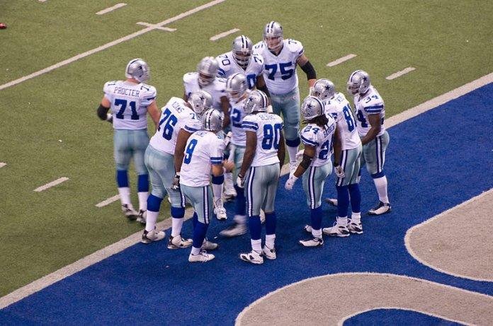 Cowboys huddle at Texas Stadium.  Photo in the    public domain