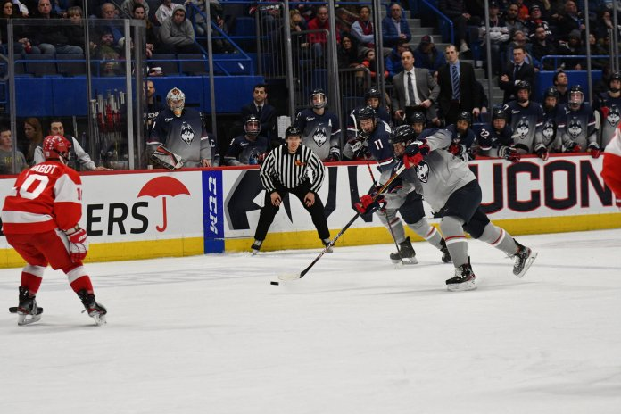 UConn defeated BU in overtime Friday night in the XL Center. Ben Freeman scored the game-tying goal with 56 seconds left before Sasha Payusov finished the game-winner just 19 seconds into overtime.  Photo by Kevin Lindstrom/The Daily Campus.