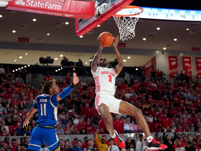 The No. 25 Houston Cougars gave Tulsa a beatdown to start off last week, beating the Golden Hurricane 76-43. Caleb Mills scored 27 points off the bench in the win.  Photo by David J. Phillip/AP.