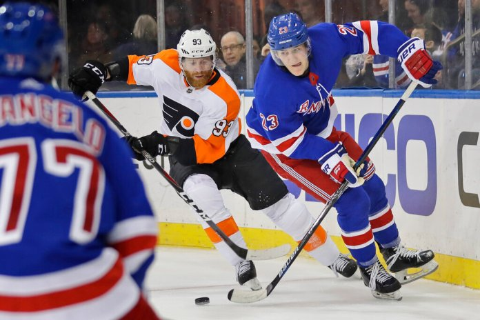 Philadelphia Flyers' Jakub Voracek, left, and New York Rangers' Adam Fox compete for the puck during the third period of the NHL hockey game, Sunday, March 1, 2020, in New York. The Flyers defeated the Rangers 5-3.  Photo by Seth Wenig/AP