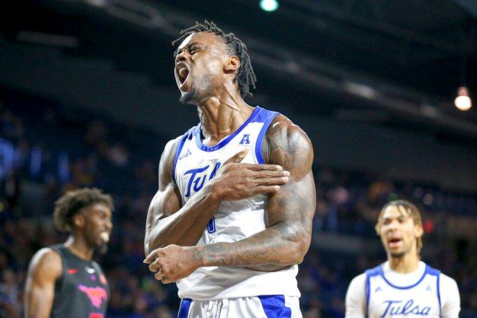 Tulsa forward Martins Igbanu yells after making a basket while being fouled during a game last Saturday.  Photo courtesy of Ian Maule/Tulsa World via AP