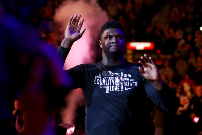 New Orleans Pelicans forward Zion Williamson enters the court before the team's game against the Cleveland Cavaliers in New Orleans.  Photo courtesy Rusty Costanza/AP