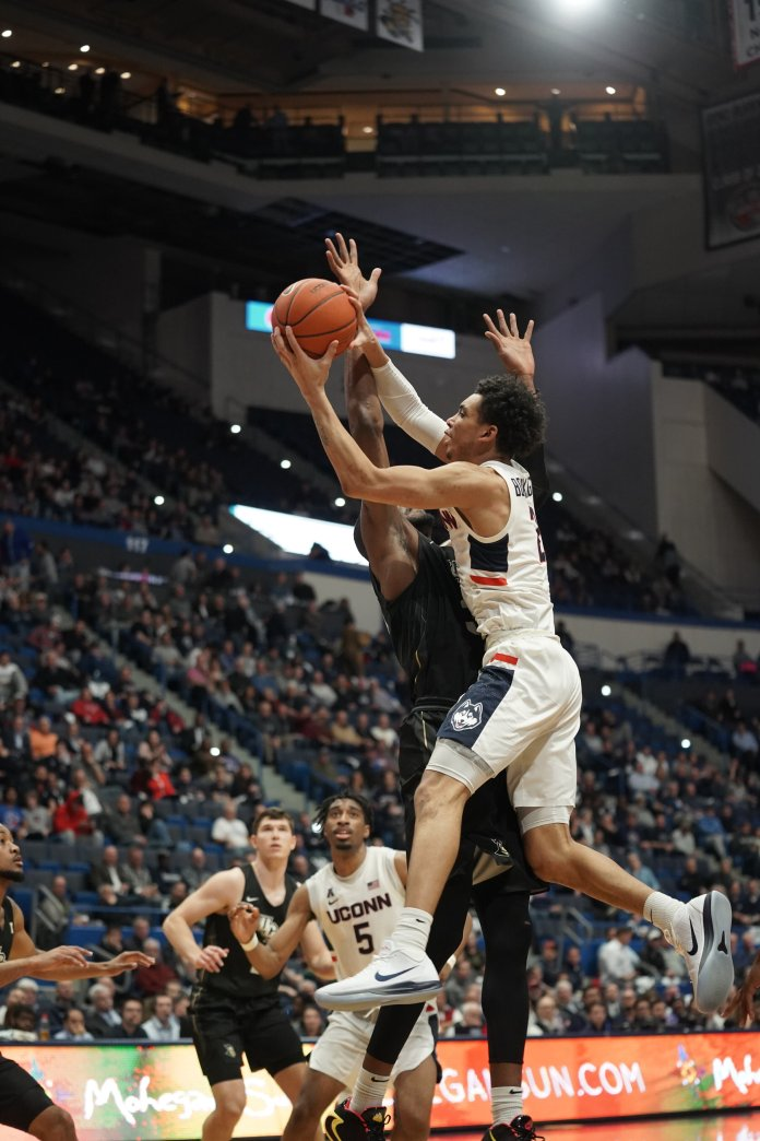 UConn men's basketball's James Bouknight goes up for a layup in the Huskies 81-65 win over UCF.  Photo by Eric Wang/The Daily Campus