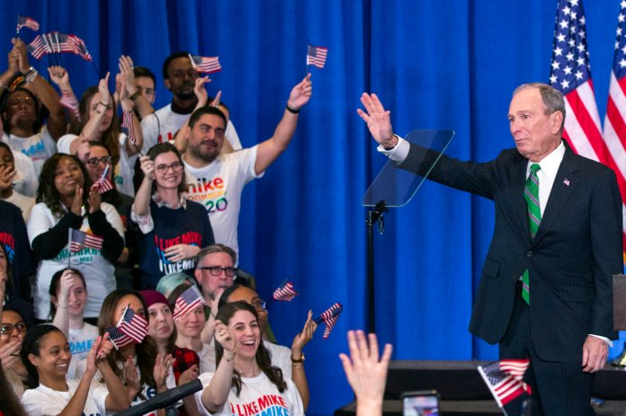 Former Democratic presidential candidate Mike Bloomberg waves to supporters as he announces the suspension of his campaign and his endorsement of former Vice President Joe Biden for president in New York Wednesday , March 4, 2020.  Photo courtesy of Eduardo Munoz Alvarez / AP Photo.