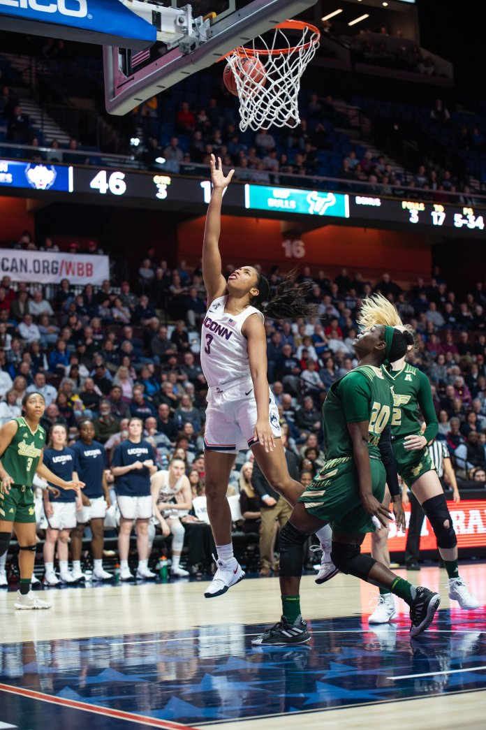 The UConn Women's basketball team defeats USF 79-38 the the AAC Semifinal match at Mohegan Sun Arena. Megan Walker ended the game with 21 points.  Photo by Charlotte Lao/The Daily Campus