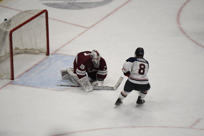 The UConn men's hockey team stunned No. 8 UMass with a pair of late goals Friday. They beat the Minutemen 3-2 Friday but lost 4-3 Saturday.  Photo by Mike Mavredakis/The Daily Campus
