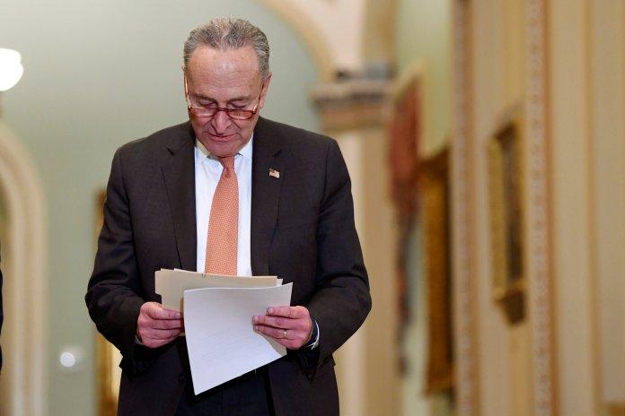 Senate Minority Leader Sen. Chuck Schumer of N.Y., walks on Capitol Hill in Washington, Tuesday, March 10, 2020. (AP Photo/Susan Walsh)