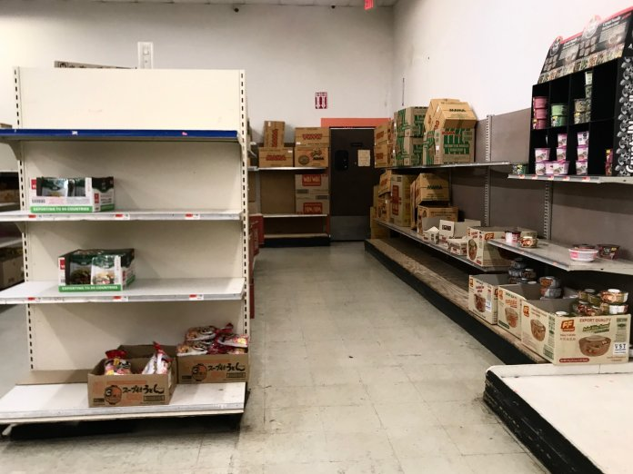 Shelves usually stocked with ramen at A Dong Supermarket, an Asian grocery store in West Hartford Connecticut, are almost empty following the announcement of a statewide closure of grocery stores by 8 p.m.  Photo by Kimberly Nguyen/The Daily Campus