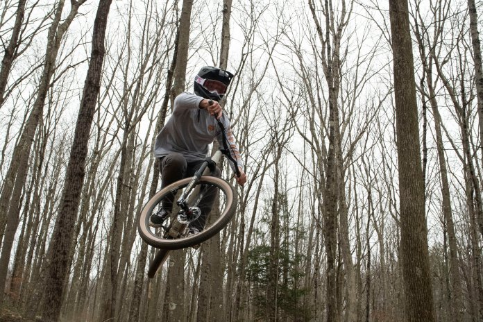 A UConn student jumps his bike in 20 degree weather to enjoy some trails near the Meshomasic State Forest on the eighteenth of January.  Photo by Kevin Lindstrom/The Daily Campus