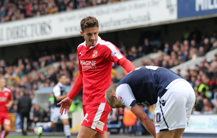 Bradley Barry of Swindon Town complains to Steve Morison of Millwall.  Photo in the    public domain