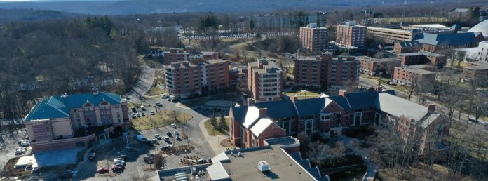 Drone shot of South and Alumni Residential Halls.   University of Connecticut Residential Life updated student housing pick times to occur mid-to-late April after being delayed due to UConn's closure in response to the coronavirus outbreak.  Photo courtesy of Eric Wang / The Daily Campus.