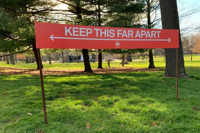 Signage urging social distancing is seen in Prospect Park in the Brooklyn borough of New York, Wednesday, April 8, 2020.0 At a time like this, getting accurate news is more important than ever. There is a plethora of misinformation spreading around the world like wildfire, and some of this has dangerous consequences.  Photo courtesy of Wong Maye-E / AP Photo.