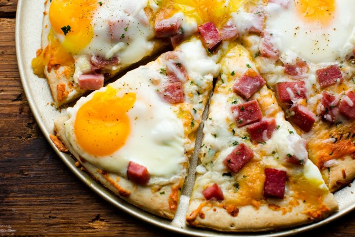 Easy and delicious, a breakfast pizza is the next thing to add to your list of dishes to try out in the kitchen.  Photo courtesy of delish.com.