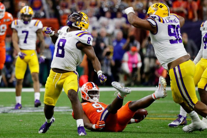 LSU linebacker Patrick Queen celebrates after tackling Clemson running back Travis Etienne during the second half of the NCAA College Football Playoff national championship game in New Orleans. Queen was the defensive player of the game.  Photo by Sue Ogrocki, File/AP
