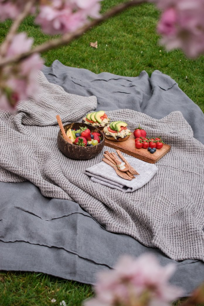 A picnic is a great way to have a stay-cation this summer.  Photo by    Maria Ilves    on    Unsplash