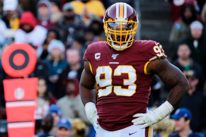 In this Dec. 15, 2019, file photo, Washington Redskins defensive end Jonathan Allen stands on the field during an NFL football game against the Philadelphia Eagles in Landover, Md. The Washington Redskins have exercised the fifth-year option on defensive lineman Jonathan Allen's rookie contract. The team announced the expected move Monday, April 27, 2020, in the aftermath of the NFL draft. (AP Photo/Mark Tenally, File)