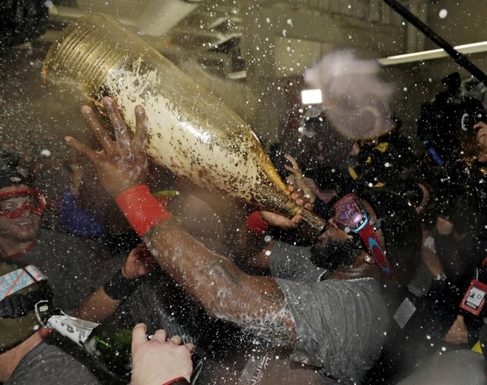 It's been a rough semester, drink up everyone (who's legal). Gold bottles.  Photo courtesy of Jared Carrabis on    Twitter