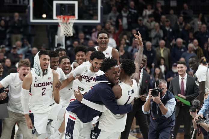 The UConn men's basketball team celebrated their Senior Night where seniors Christian Vital, Alterique Gilbert, Temi Aiyegbusi and Mamadou Diarra made their last home appearance as a Husky. In the final home game of the year against University of Houston, UConn won 77-71. Vital made eight free throws in a row within the last minute of the game to keep the team up.  Photo by Eric Wang/The Daily Campus