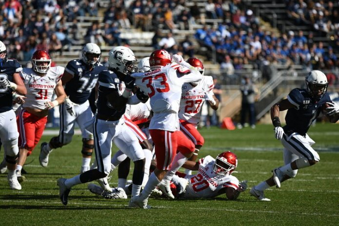 The one bright spot on UConn's offense was the running game. Kevin Mensah and Art Thompkins provided a thunder and lightning punch that kept the Huskies within striking distance in many games.  Photo by Eric Wang/The Daily Campus.