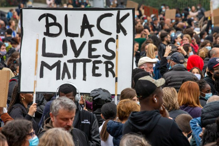 Several thousand demonstrators take part in an anti-racism demonstration, against police violence and in memory of George Floyd, during a Black Lives Matter (BLM) protest, in Geneva, Switzerland, Tuesday, June 9, 2020. Floyd, a black man, died after he was restrained by Minneapolis police on May 25, igniting protests in the U.S., and globally.  Photo by Salvatore Di Nolfi/Keystone via AP