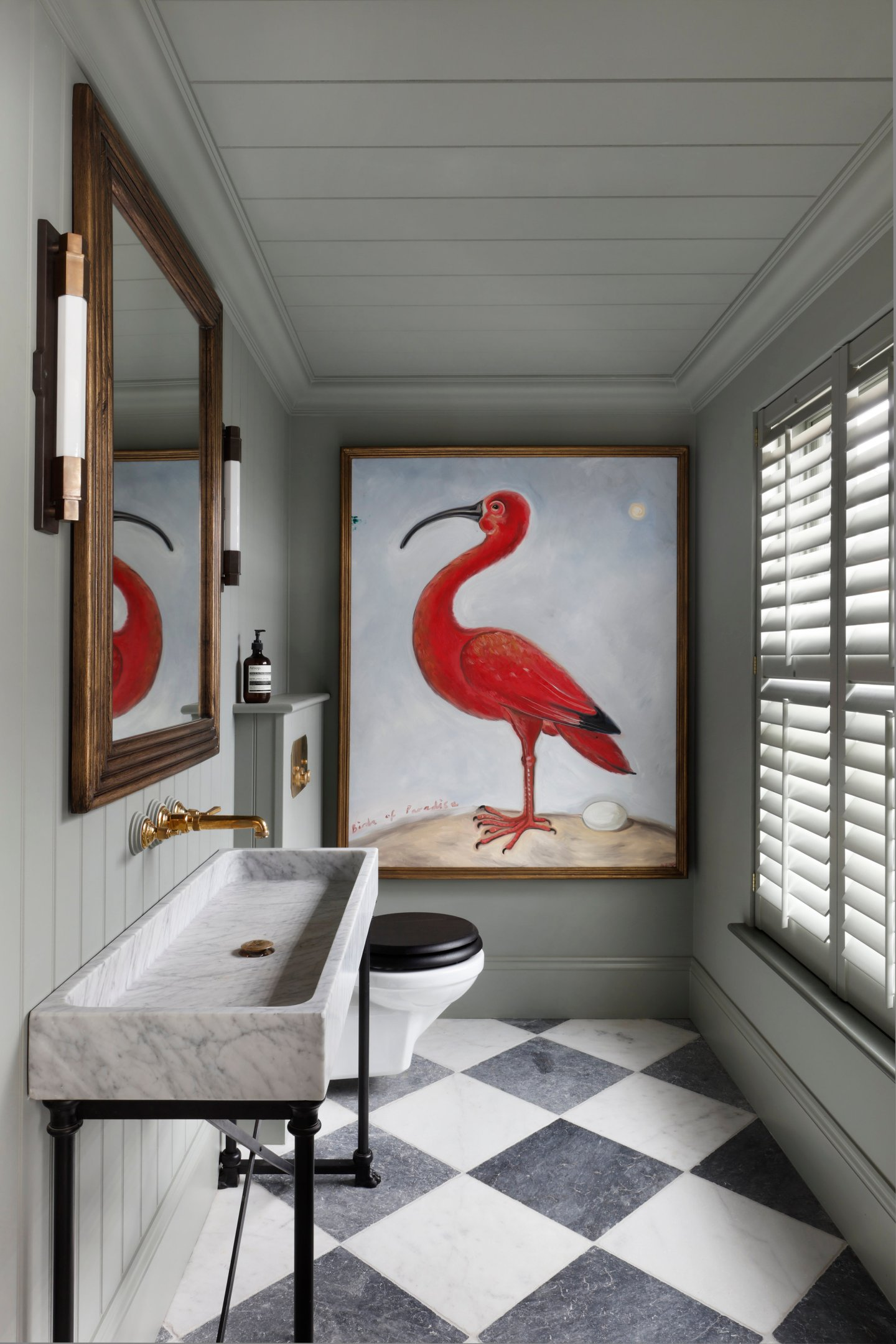 Oversized Wall Art of a Bird hung in the Powder Bathroom
