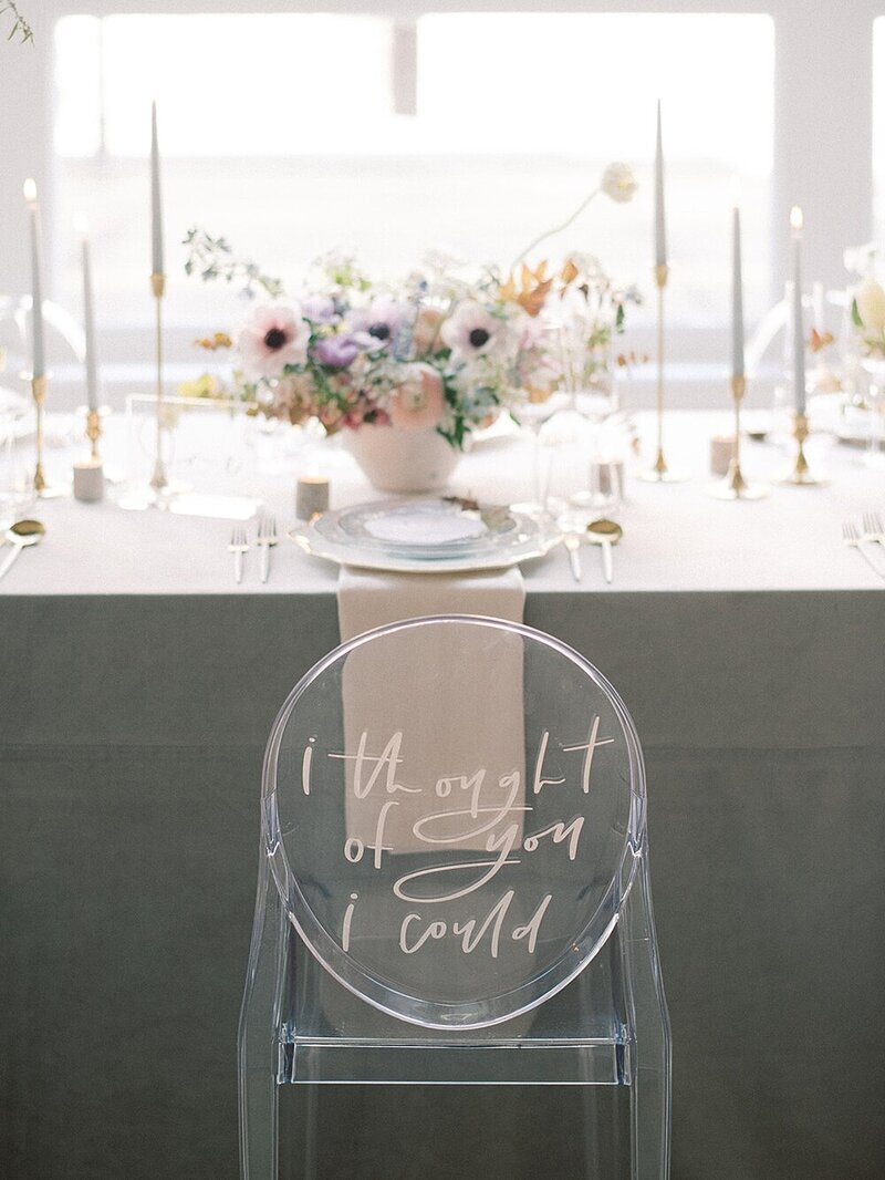 Wedding chair signs are a favorite design element and the team at Leigh and Mitchell have elevated that through their brilliant use acrylic chairs, also known as Ghost Chairs, to share a beautiful wedding quote on. Chairs from CORT Party Rental , Whiskers and Willow Photography , Willow & Ivy Events