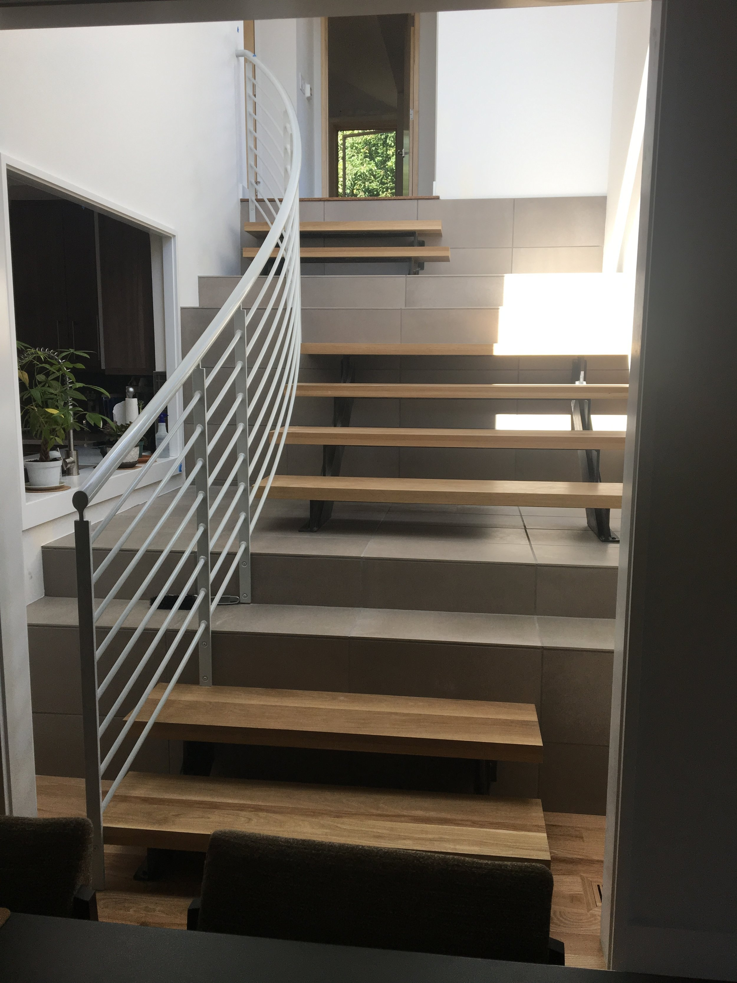 On Stairs — M Gerwing Architects   Wood And Tile Stairs   Rocell Living Room   Tile Floor   Basement   Quarter Round Stair Hardwood   White