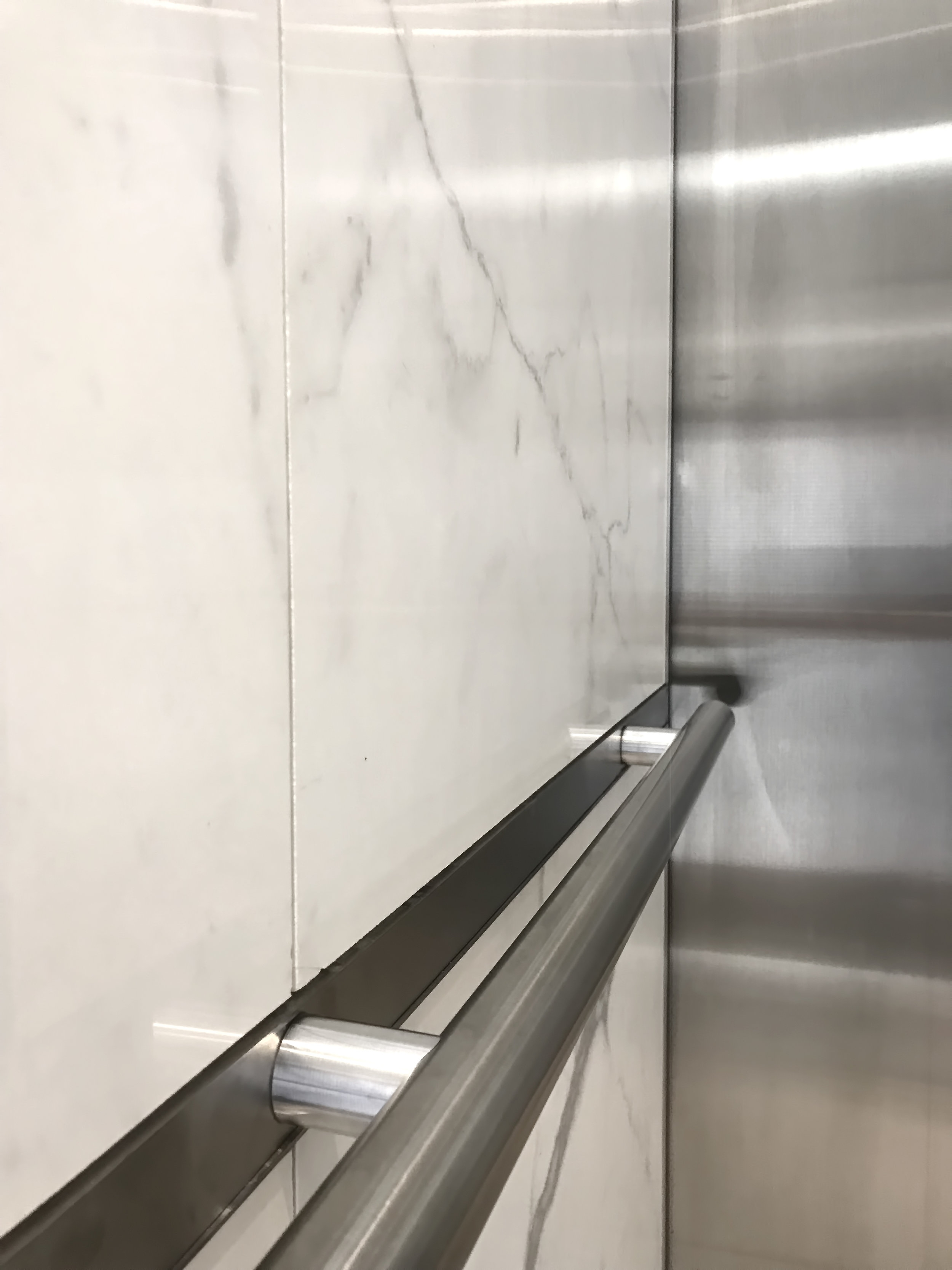 Elevator Handrail Products Designs — Elevator Scene | Brushed Stainless Steel Handrail | Rectangle | Glass Panel Wooden Handrail | Brushed Chrome | Matte Finish | Flat Bar Steel