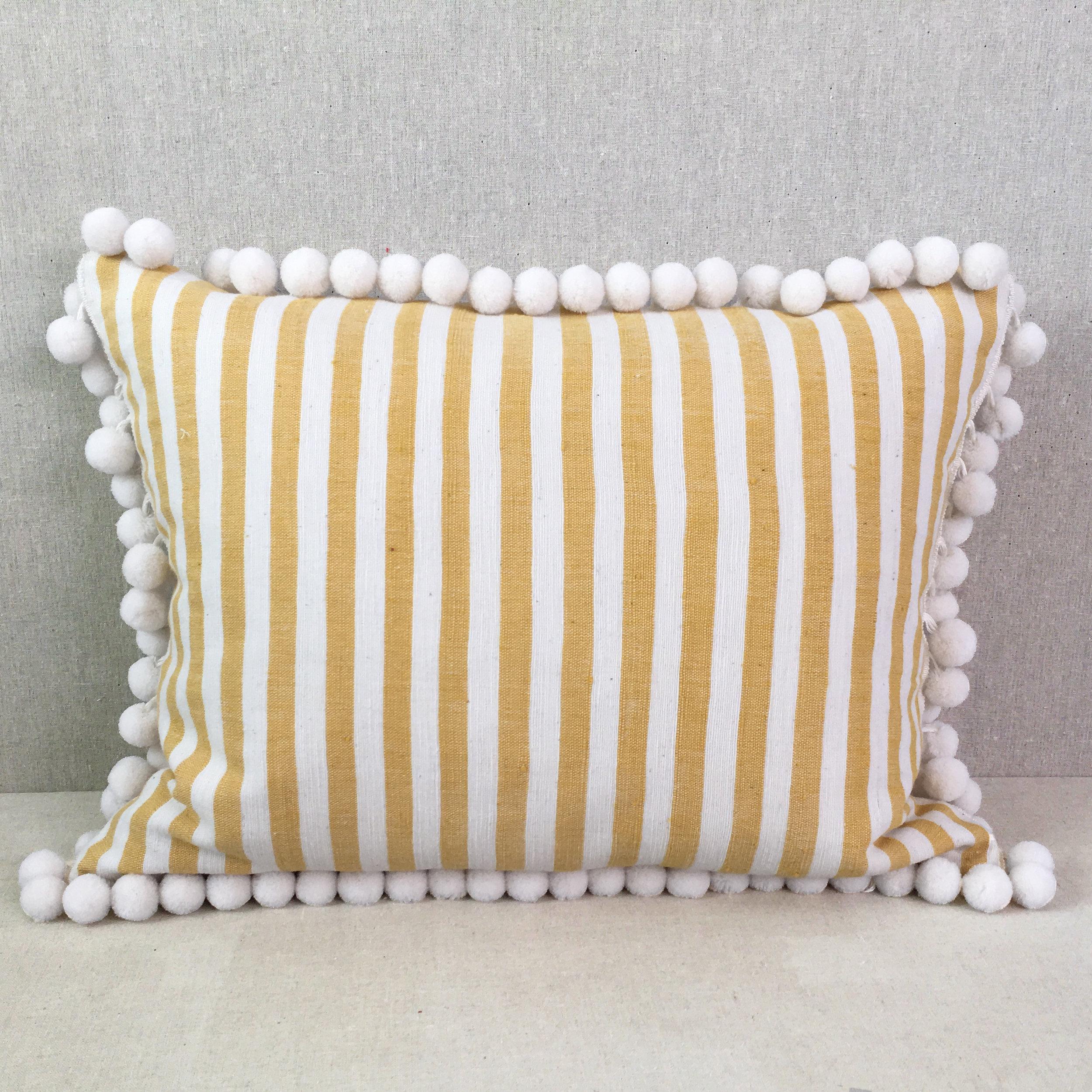 small stripe pom pom pillow yellow lotus bleu design