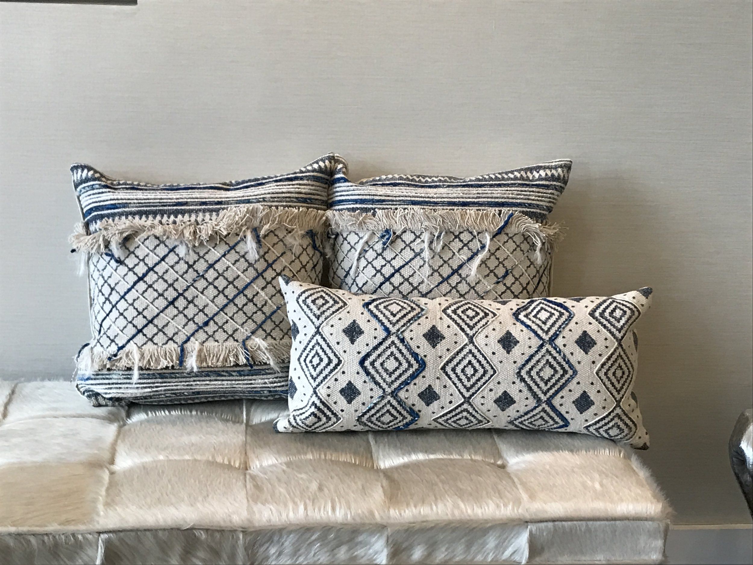 blue and beige lumbar pillow with fringe threshold interiors